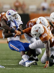 AUSTIN, TX - AUGUST 31:  Joseph Ossai #46 of the Texas Longhorns and Josh Thompson #29 tackle Israel Tucker #22 of the Louisiana Tech Bulldogs in the second quarter at Darrell K Royal-Texas Memorial Stadium on August 31, 2019 in Austin, Texas.  (Photo by Tim Warner/Getty Images)