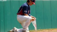 Holbrook Little League's Chris Cartnick scoops up some