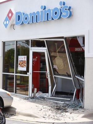 Car crashes into Domino's Pizza
