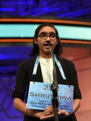 "Shruthika Padhy, 10, of Cherry Hill, N.J., correctly spells ""appendicular"" in Round 3 of the 2016 Scripps National Spelling Bee at the Gaylord National Resort and Convention Center."