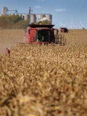 Neighbors in Radcliffe, Iowa, pitched in to help a farmer harvest his crops after he broke his hip.