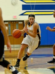 Lydia Crist drives to the hoop for Greencastle
