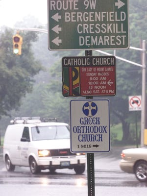 Tenafly, NJ. 08/23/2001 Church signs are an issure in the Eruv case. These signs are on the corner of Engle St. and W. Clinton Ave.
