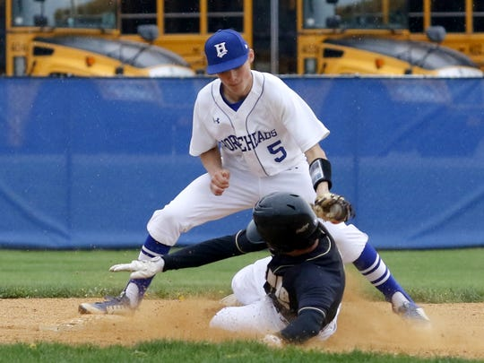 Blake VanWoert of Corning is tagged out by Horseheads second baseman Trey Princiotto while going for a double Friday during the Hawks' 7-6 victory at Horseheads High School.