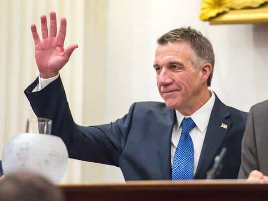 Governor Phil Scott waves after being sworn in at the Statehouse in Montpelier on Thursday, January 5, 2017