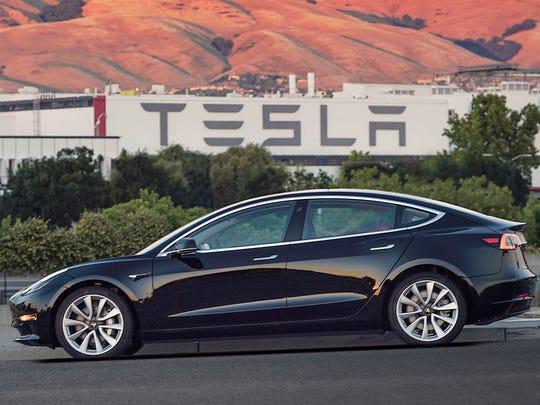 This image provided by Tesla Motors shows the Tesla Model 3 sedan.