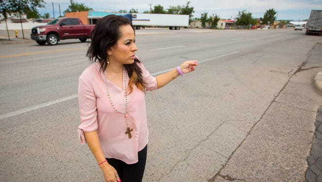 On Saturday, August 13, 2016, Erika Alaniz-Silva points out where she and her husband were driving in Hatch on Franklin Street when they witnessed the start of the traffic stop that eventually led to Hatch Police Officer Jose Chavez being shot by a suspect the afternoon before.