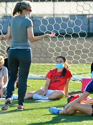 Durfee girls' soccer tri-captain Charlotte Misturado is all ears while coach Amie Roache addresses the team during a practice on Wednesday.