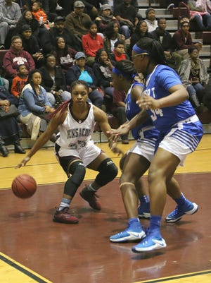 Pensacola's Valerie Samuel (25) dribbles the ball near the baseline while trying to get around the Washington defense Friday night at Pensacola High School.
