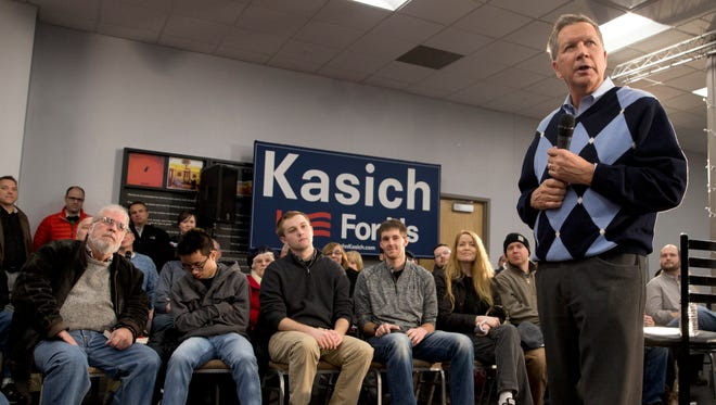 Republican presidential candidate John Kasich speaks during a town hall meeting Wednesday in Davenport, Iowa.