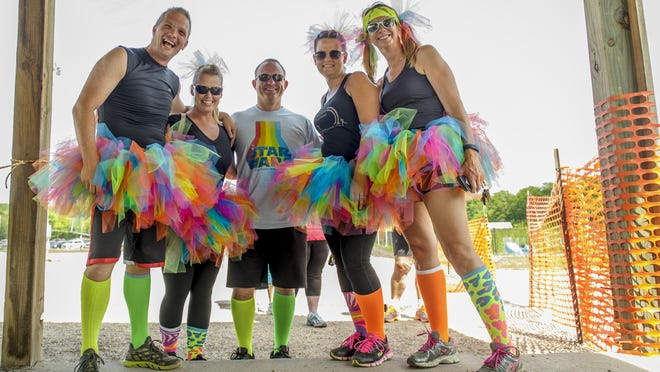 Sleepy Hollow hosted its annual Beer Run event in support of Leukemia and Lymphoma Society July 9. Participants enjoyed a variety of games and activities, music and beverages. Jim Kennedy, Alisa Buchli, Scott Buchli, Kari Kennedy and Vicky Norrish wore very colorful outfits.