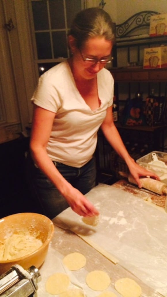 Denise Henhoeffer treats our work space with more flour. You will use a lot of flour. Keep extra on hand.