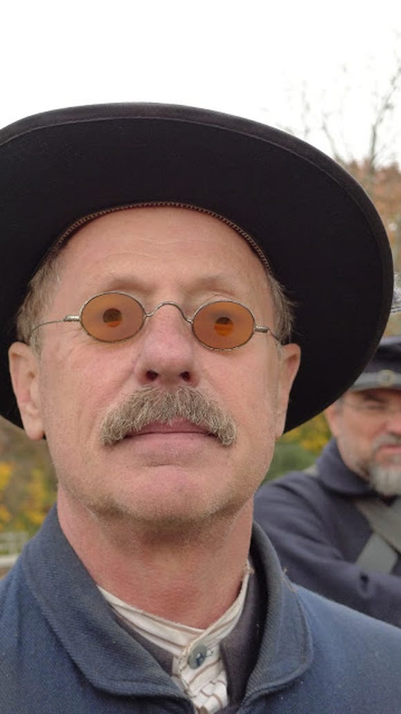 This Civil War reenactor models sharpshooter's glasses at an encampment a month ago at Hanover Junction in York County.