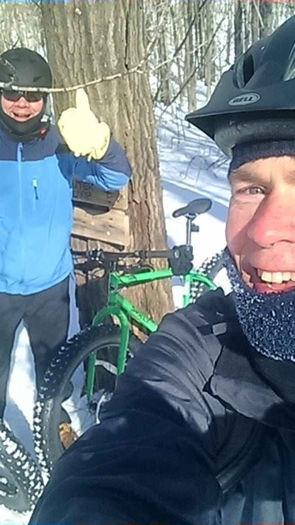 Thumbs up to fat-tire bike riding in Duluth, Minn., me on the left, Mark Nicklawske on the right.