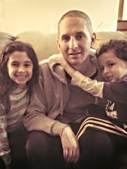 Darren Lederman, who recently relapsed with adult Acute Myeloid Leukemia (AML), with his children, Emma and Noah, last year.