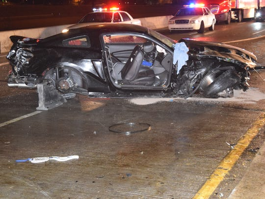 Police say two cars were street racing when one lost control and struck a car traveling in the opposite direction Wednesday, Dec. 23, 2015. All three occupants of that other car were killed.