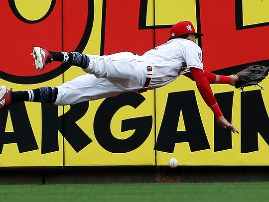 Cincinnati Reds center fielder Billy Hamilton dives