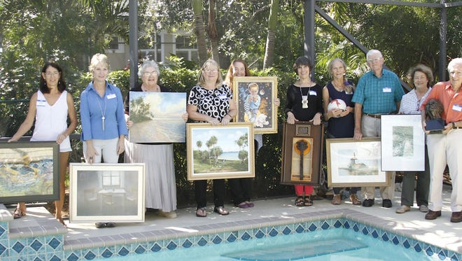 From left, the artists are: Sherry Haaland; Dawn Miller; Charlotte Dickinson; Dawn Mill; Merana Cadorette; Joan Earnhart; Peggy Thomas; Russell Hahn; Betsy Kurzinger; and George Paxton.