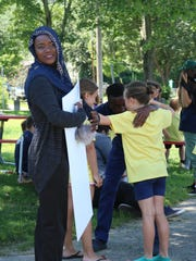 Dahero Iftin a sophomore at the Community College of Vermont is using her scholarship to study to become a social worker to help new American's transition, at the Boys and Girls Club on July 11, 2017.