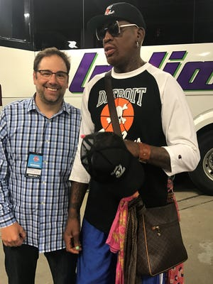 Peter Ginopolis with Dennis Rodman before the Pistons game Monday night.