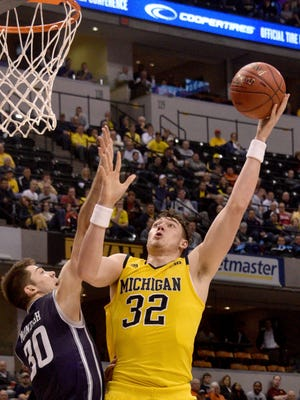 Michigan forward Ricky Doyle averaged 4.9 points and 2.5 rebounds in 67 games for the Wolverines.