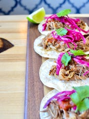 Carnitas street tacos from Louie's Wine Dive are shown.