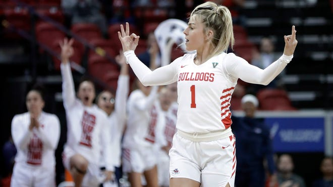 Fresno State's Haley Cavinder reacts after sinking a 3-point shot during the first half of an NCAA college basketball game against Boise State for the Mountain West Conference women's tournament championship Wednesday, March 4, 2020, in Las Vegas. (AP Photo/Isaac Brekken)