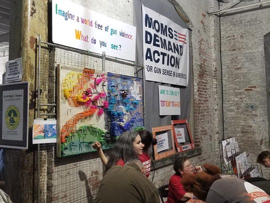 "The Moms Demand Action organization, which was created to demand action from state and federal legislators, companies and educational institutions to establish common-sense gun reforms, was present with a booth at the Art All Night event. Art pieces asking viewers to ""imagine a world free of gun violence"" were highlighted."