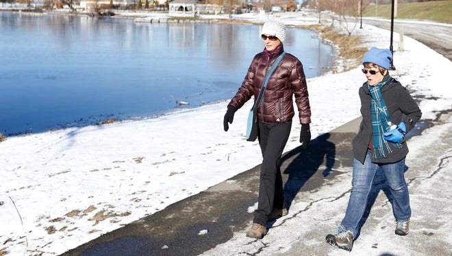 Judy Payne, of Campbell, and Mickie Harris, of Breesport, walk around Eldridge Lake Wednesday during their weekly meetup.