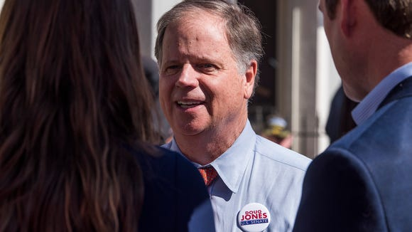 U.S. Senate candidate Doug Jones talks with people attending his campaign stop at Moe's Original BarBQue in Montgomery, Ala. on Wednesday October 25, 2017.