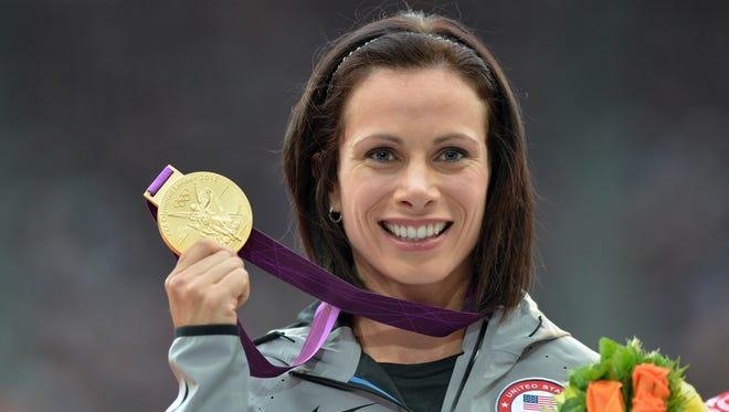 Jenn Suhr celebrates winning the gold at London in 2012.