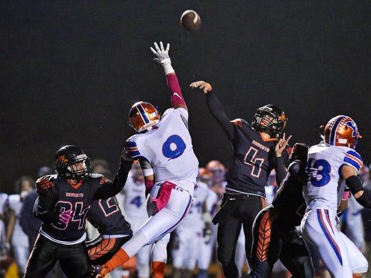 Northeastern quarterback Zech Sanderson throws a pass