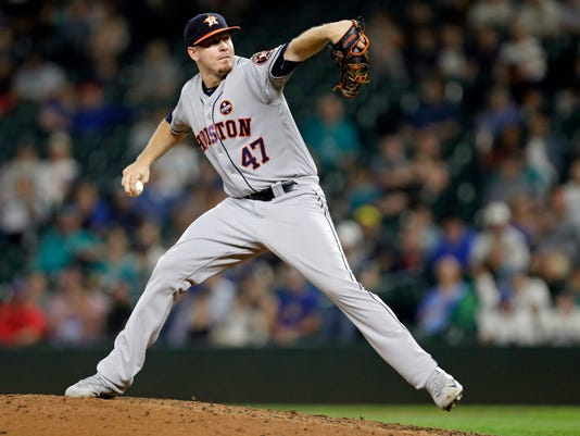 FILE - In this Sept. 6, 2017, file photo, Houston Astros closing pitcher Chris Devenski works against the Seattle Mariners during a baseball game in Seattle. These playoffs could be when middle men like the Yankees' Chad Green or Houston's Chris Devenski become household names.  (AP Photo/John Froschauer, File)