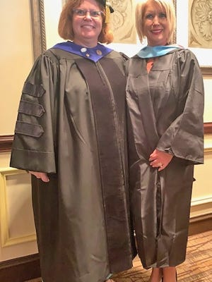 Dr. Judy Beck (left), the dean of the School of Education at USC Aiken, and MaryJo Weegar (right).
