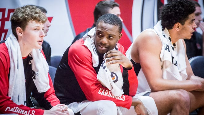 Ball State's Francis Kiapway sits on the bench at Worthen Arena Feb. 20, 2018.