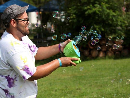 Matt Johnson sets off an explosion of bubbles during