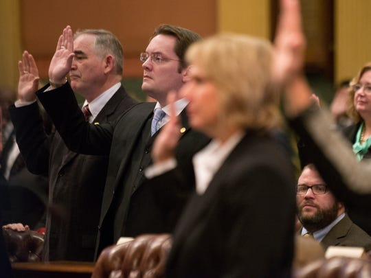 State Rep. Ben Frederick is sworn into the Michigan House of Representatives on Wednesday, Jan. 11, 2017 during the first session of the 99th Legislature at the Capitol in downtown Lansing.