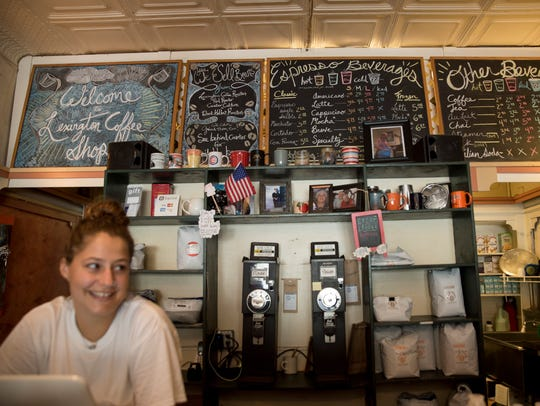 McKenzie White works the cash register at the Lexington Coffee Shop June 25, 2018. She said she received many phone calls asking whether conservatives are welcome at their shop.