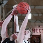 River View senior Jonathan Dart and Coshocton senior Josh Williams battle for a rebound Friday during Coshocton's 51-26 victory.