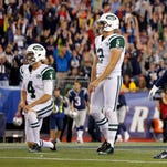 New York Jets kicker Nick Folk reacts after missing a field goal at the end of the game against the New England Patriots at Gillette Stadium. The Patriots defeated the Jets 27-25.