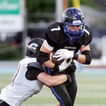 South Medford's Brady Breeze carries the ball as West Salem's Connor Mattison attempts to tackle him in a 2013 game. Breeze, who transferred to Central Catholic, has committed to playing for the Ducks as part of the 2016 recruiting class.
