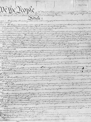 -  -Text: This is an undated photo of the Constitution of the United States. (AP Photo) SHOOT DATE IS AN ESTIMATE
