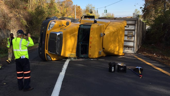 A tractor-trailer is flipped over on the Exit 4 entrance ramp to southbound Interstate 684, Oct. 30, 2014. The truck was carrying food products. No one was injured.