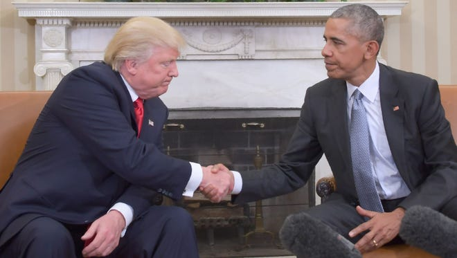 President Obama shakes hands with President-elect Donald Trump in the Oval Office at the White House on Thursday.