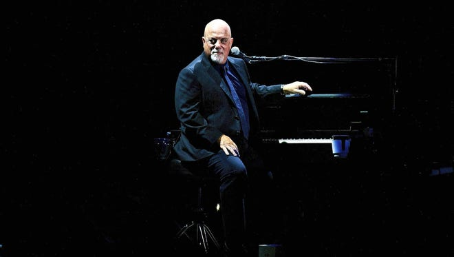 Billy Joel performs for a record 65th time at Madison Square Garden on Wednesday, July 1, 2015, in New York.