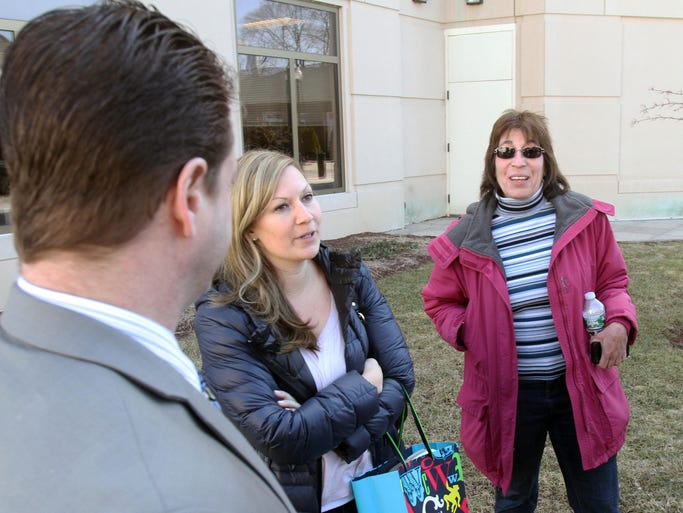 From left, Jurors  Gwen Wilkinson and Debbie Silmon talk to defense attorneys outside the Putnam County Courthouse following the acquittal of Alex Hossu April 3, 2014.