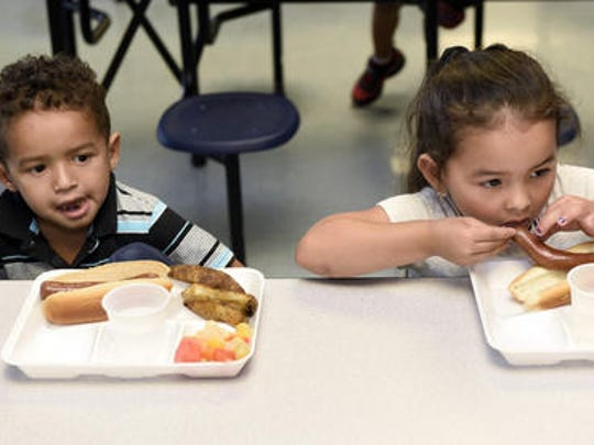 Christian Rene, left, and his cousin Emely Reivera enjoy their lunch on Monday, June 27, 2016 at BOPIC summer camp at Chambersburg Area Middle School South. BOPIC is one of several organizations providing summer meals to children in the Chambersburg and Shippensburg areas this summer.
