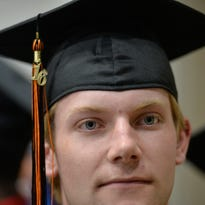 St. Cloud Tech graduating senior Justin Hagstrom takes in the sights as he waits in line for commencement to start Thursday, May 26 at River's Edge Convention Center. Tech graduated 314 seniors.