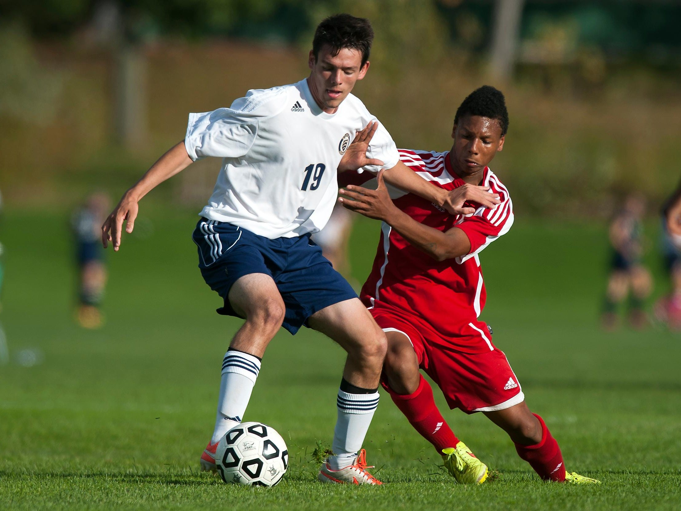 CVU's Trey Tomasi, right, battles for the ball with Essex's Danilo Salgado during a high school boys soccer game in 2014.