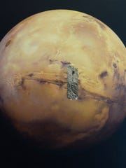 From Cranbrook, attached to a model of Mars is an